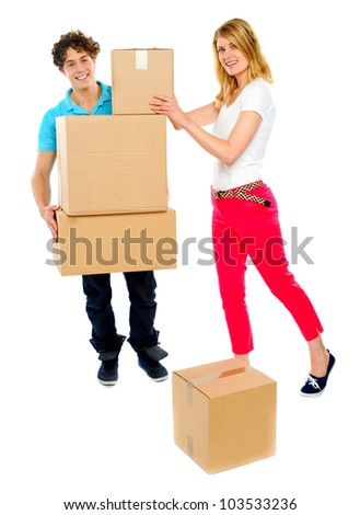 American woman placing boxes as guy holds the stack. All on white background