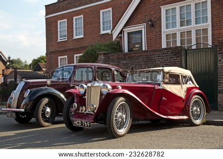 AMERSHAM, UK - SEPTEMBER 7: A vintage MG sportscar is lined up alongside another vintage automobile to stand on public display at the annual Amersham Heritage Day show on September 7, 2014 in Amersham - stock photo