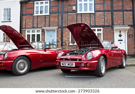 AMERSHAM, UK - SEPTEMBER 7: Two classic MG sports cars stand on public display at the annual Amersham Heritage Day show on September 7, 2014 in Amersham - stock photo