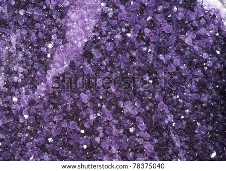 Amethyst crystals close-up. Druze within a very large geode. - stock photo