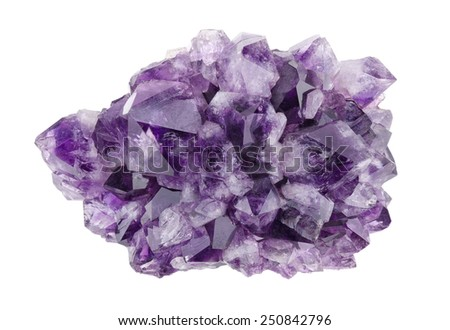 Amethyst directly above over white background, a violet variety of quartz, often used in jewelry. Silica, silicon dioxide, SiO2. - stock photo