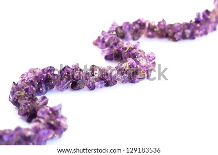 Amethyst necklace isolated on white background. - stock photo