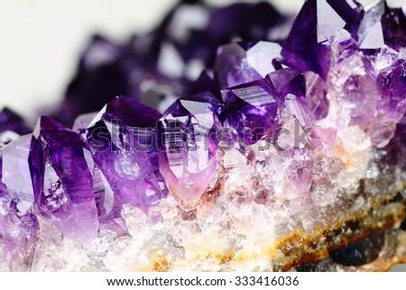 Amethyst stone detail, violet variety of quartz. - stock photo