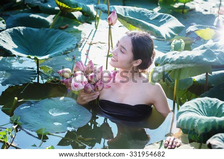 amezing of beautiful young woman Farmer  collecting lotus in garden. thai lifestyle  people in local,Thailand, vintage filter effect - stock photo