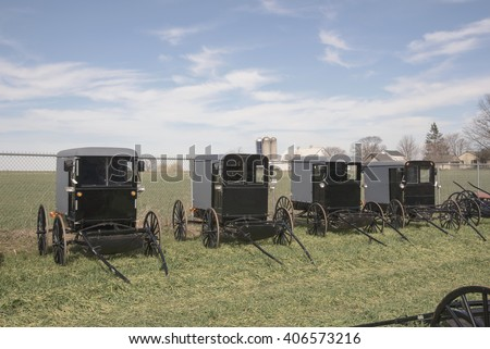 Amish buggies up for auction in Pennsylvania. - stock photo