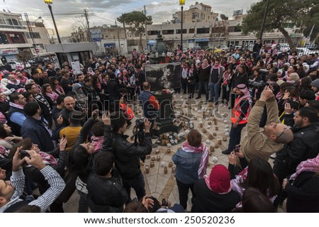 AMMAN/JORDAN - FEB 06 2015: Jordanians gather in Amman to light candles in memory of the Jordanian fighter pilot Moaz al-Kasasbeh who was burnt alive by ISIS militants in Syria.
