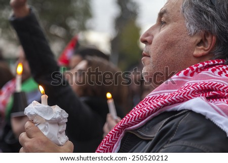 AMMAN/JORDAN - FEB 06 2015: Man (Un-known) holds a candle in memory of the Jordanian fighter pilot Moaz al-Kasasbeh who was burnt alive by ISIS militants in Syria.