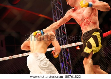 AMMAN, JORDAN - SEPTEMBER 8 : Jack Hermansson (Right) defeats Mike Ling (Left) by Knockout at 3:30 of Round 1, Cage Warriors Fight Night 2, Fight Card on September 8, 2011 in Amman, Jordan - stock photo
