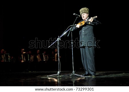 AMMAN - MARCH 15: Blind singer Dagaev from Chechnya Wainakh ensemble performing for Jordanian Audience and royal family, during Kadyrov's visit to Jordan. March 15, 2011 in Amman, Jordan.