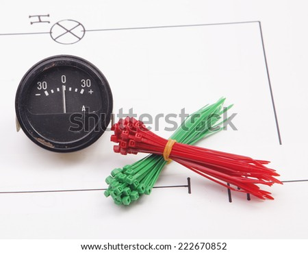 Ammeter and electric wire on a background of the electric scheme - stock photo