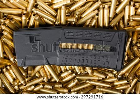 Ammunition and magazine background. - stock photo