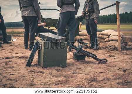 Ammunition box on the ground with machine gun case - stock photo