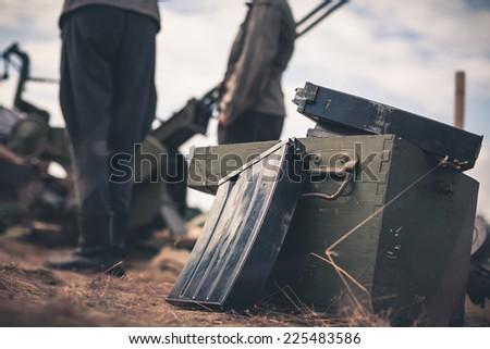 Ammunition box on the ground with machine gun case - stock photo