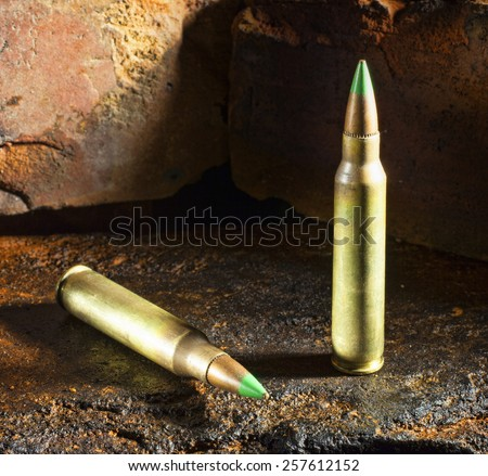 Ammunition considered armor piercing on a brick background - stock photo