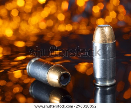 Ammunition designed for a pistol that has a hollow pointed bullet with an orange background - stock photo