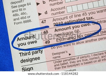 Amount owe in the income tax return - stock photo