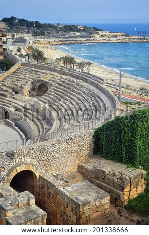 Amphitheater of Tarragona - an old roman ruin of Spain included in World Heritage Site by UNESCO. The city is a famous tourist destination with beaches and sea. - stock photo