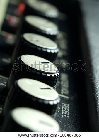 Amplifier knobs closeup,for music,sound,entertainment themes - stock photo