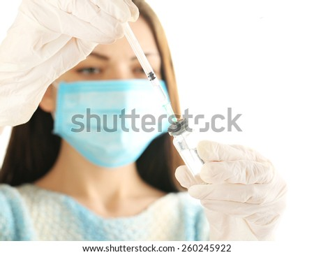 Ampule and syringe in hands of doctor - stock photo