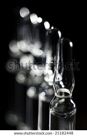 ampules on black - stock photo