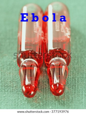 Ampules with red liquid OHB 12 vitamin with sign Ebola - stock photo