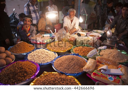 AMRAVATI, MAHARASHTRA, INDIA - 28 JUL : unidentified street vendors and People shopping in the street market during Ramzan fasting month, 28 july 2014, Amravati, Maharashtra, India
