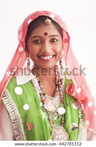 AMRAVATI,MAHARASHTRA, INDIA - NOV 08 : Unidentified Beautiful young girls dressed as tribal women for dance on occasion of the Hindu religious festival, Amravati, Maharashtra,India, 8 November 2014. - stock photo