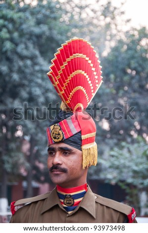AMRITSAR - DECEMBER 19: An Indian guard at the Wagah border on December 19, 2009 in Amritsar, India. Guards participate in the changing of the guards at sundown, when the Pakistan border is closed. - stock photo