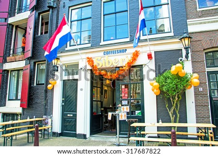 AMSTERDAM APR 27:Kings Day in Amsterdam, decorated dutch coffee shop on April 27. 2015 in the Netherlands - stock photo