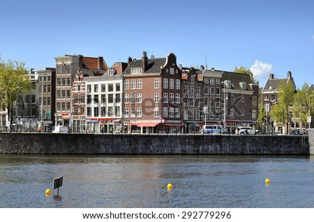 AMSTERDAM - APR 30: Streets and canals in the city center of Amsterdam on April 30. 2015 in Netherlands. - stock photo