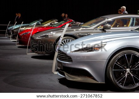 AMSTERDAM - APRIL 16, 2015: A row of Aston Martin cars at the AutoRAI 2015. Aston Martin Lagonda Limited is a British manufacturer of luxury sports cars, founded in 1913. - stock photo