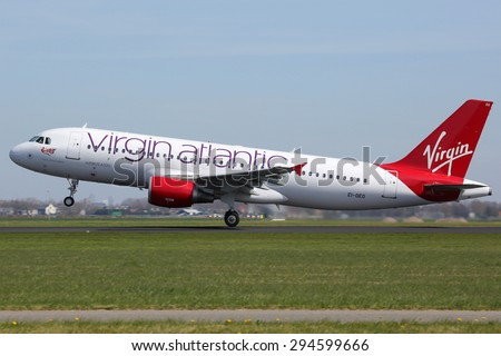 AMSTERDAM - APRIL 21:  A Virgin Atlantic Airbus A320 taking off on April 21, 2015 in Amsterdam. Virgin Atlantic is a British airline with bases at London Heathrow and Gatwick airport. - stock photo