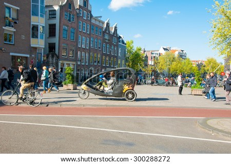 Amsterdam-April 30: Amsterdam downtown, bicycle taxi cyclist waits for clients on April 30, 2015, the Netherlands. - stock photo