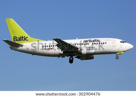 AMSTERDAM - APRIL 20: An Air Baltic Boeing 737-500 approaching on April 20, 2015 in Amsterdam. Air Baltic is the flag carrier airline of Latvia with its headquarters in Riga.