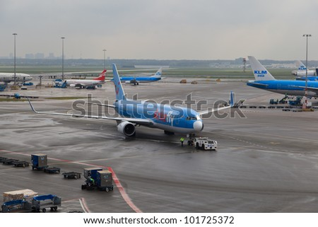 AMSTERDAM - APRIL 23: Arkefly plane landed at Schiphol Airport on April 23, 2012 in Amsterdam, Netherlands. Arkefly  operates to many destinations including Mediterranean and the United States.