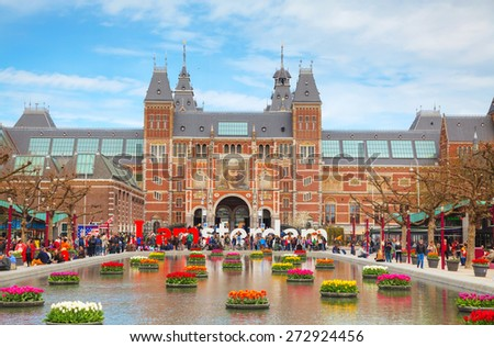 AMSTERDAM - APRIL 16: I Amsterdam slogan with crowd of tourists on April 16, 2015 in Amsterdam. Located at the back of the Rijksmuseum on Museumplein, the slogan quickly became a city icon. - stock photo