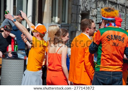AMSTERDAM-APRIL 27: Open-air party during King's Day on April 27,2015 in Amsterdam, the Netherlands. Kings Day is the biggest festival celebrating the birth of Dutch royalty.