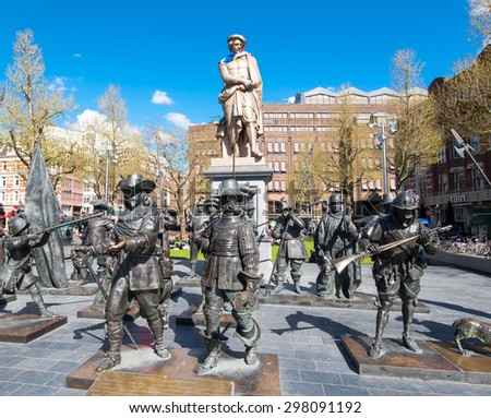 Amsterdam-April 30: Rembrandtplein (Rembrandt Square) with a bronze-cast representation The Night Watch, by Russian artists Mikhail Dronov and Alexander Taratynov on April 30, 2015, the Netherlands. - stock photo