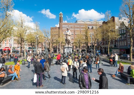 Amsterdam-April 30: Rembrandtplein with Rembrandt monument and bronze-cast representation The Night Watch, by Russian artists Mikhail Dronov and Alexander Taratynov on April 30, 2015, the Netherlands. - stock photo