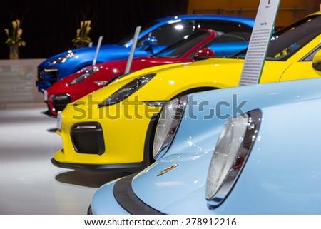 AMSTERDAM - APRIL 16, 2015: Row of Porsche sports cars at the AutoRAI 2015. - stock photo