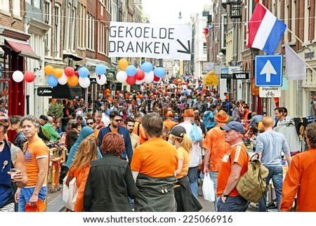 AMSTERDAM - APRIL 26: Streets of Amsterdam full of people in orange during the celebration of kings day on April 26, 2014 in Amsterdam, The Netherlands - stock photo