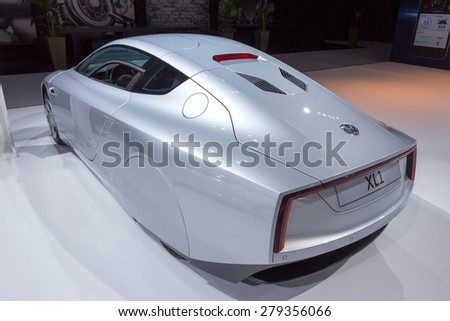 AMSTERDAM - APRIL 16, 2015: Volkswagen XL1 car at the AutoRAI 2015. The XL1 is a two-person limited production diesel plug-in hybrid designed to be able to travel 100 km on 1 litre of diesel fuel - stock photo