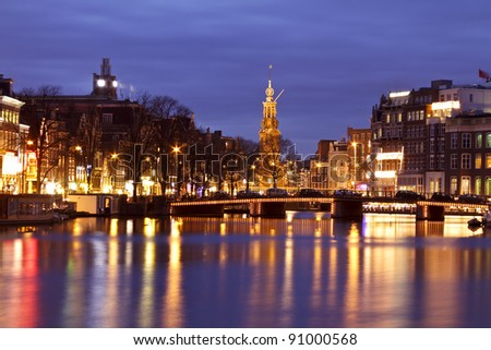 Amsterdam at night with the Munttower in the Netherlands - stock photo