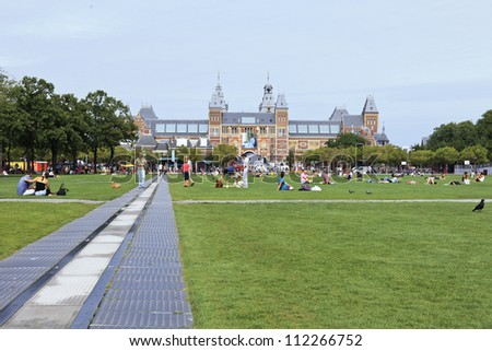 AMSTERDAM-AUG. 17, 2012. Museum square on Aug. 17, 2012 in Amsterdam. Several museums are located around the very touristy square: Rijksmuseum, Van Gogh Museum, Stedelijk Museum and Diamond Museum. - stock photo