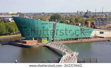 AMSTERDAM - AUG 27, 2014: The Nemo Museum in Amsterdam, Netherlands. Science Center NEMO is a science center designed by Renzo Piano since 1997. - stock photo