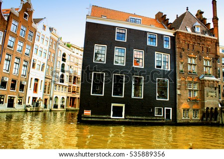 Amsterdam: august 15. 2015- Amsterdam city facades and canals with some boats and flowers in the city, Netherlands;