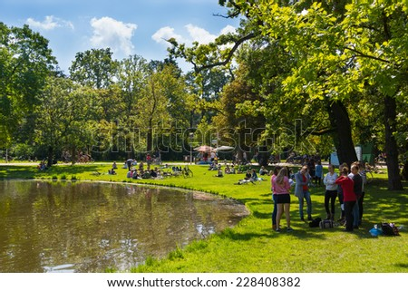 AMSTERDAM - AUGUST 27: People relax in Vondel park on August 27, 2014 in Amsterdam. Vondel Park largest and most famous park in Amsterdam - stock photo