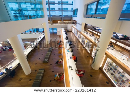 AMSTERDAM - AUGUST 26: People visit the city's public library on August 26, 2014 in Amsterdam. - stock photo