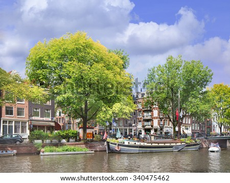 AMSTERDAM-AUGUST 24, 2014. View on Jordaan neighborhood. Originally a working-class district, Jordaan became an expensive, upscale location, home to art galleries, specialty shops and restaurants. - stock photo