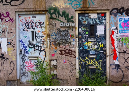 AMSTERDAM - AUGUST 26: Wall painted by graffiti on August 26, 2014 in Amsterdam. - stock photo
